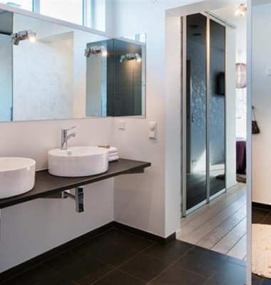 Swedish-Bathroom-Design-Home-with-Double-Sink-and-Large-Mirror-also-Round-Bath-Mat-835x549