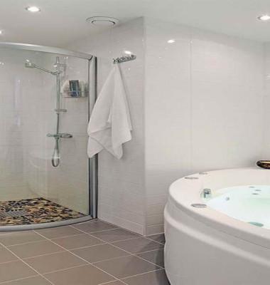 Swedish-Bathroom-Design-with-Round-Bath-Tub-and-Bath-Towel-also-Shower